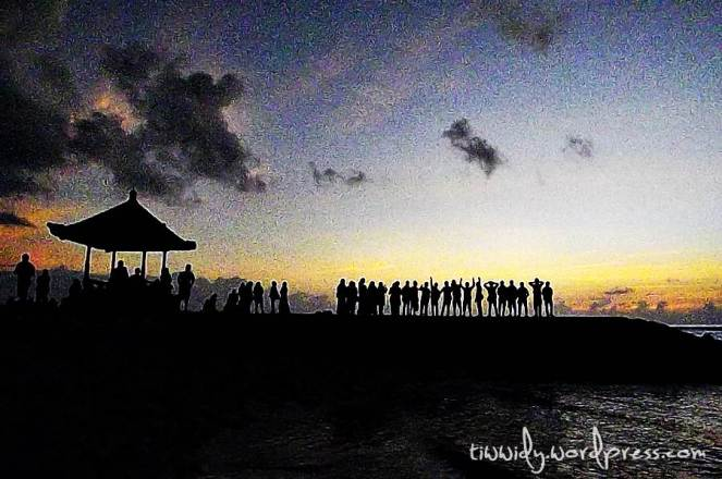 Holding Each Other Hands to welcome sunrise in Sanur, Bali
